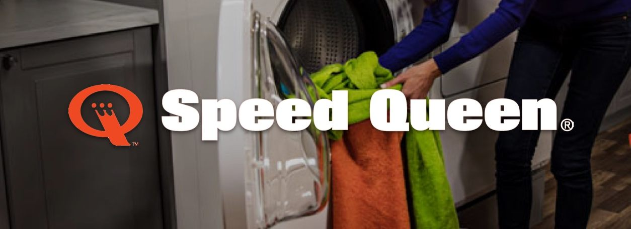 Person putting clothes in Speed Queen washing machine
